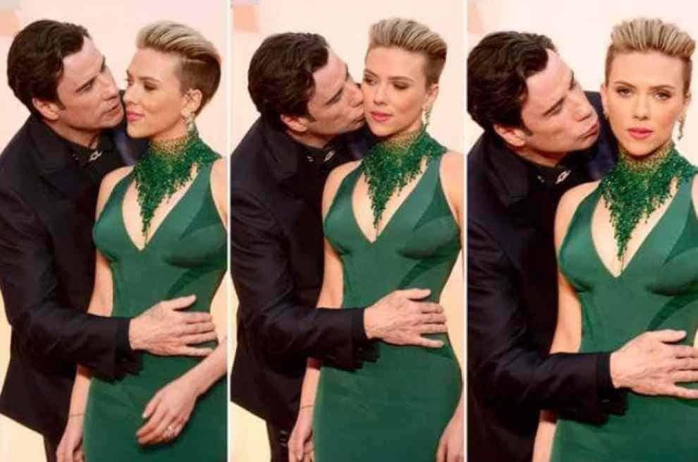 Travolta bacia Scarlett Johansson